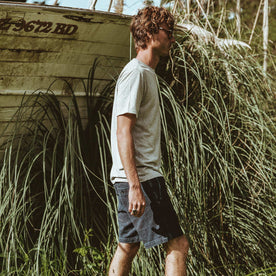 Our fit model walking next to an old boat.