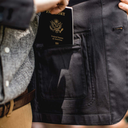 The fit model putting his passport into the hidden inside pocket