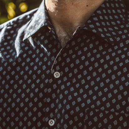 Close shot of our fit model wearing a floral shirt