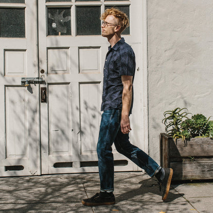 Our fit model wearing the Short Sleeve Hawthorne in Indigo Moon Phase walking in San Francisco.