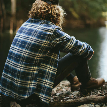the fit model in The Crater Shirt in Blue Plaid next to the lake