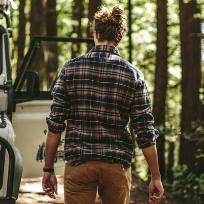 Fit model walking to his truck in the Crater Shirt in Burgundy Plaid