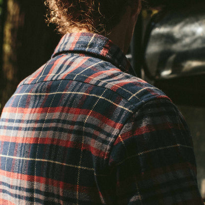 The fit model facing away in the Crater Shirt in Burgundy Plaid