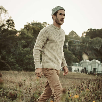 Our fit model walking to the dock in The Fisherman Sweater.