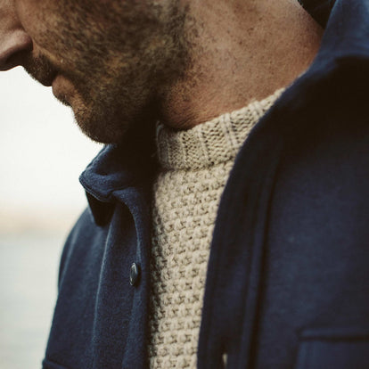 A close up shot of our fit model wearing the Fisherman Sweater
