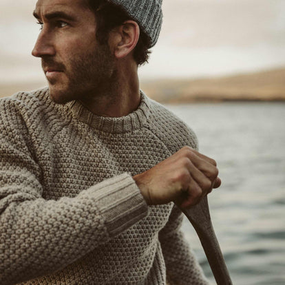 Our fit model out on the water with the Fisherman Sweater.