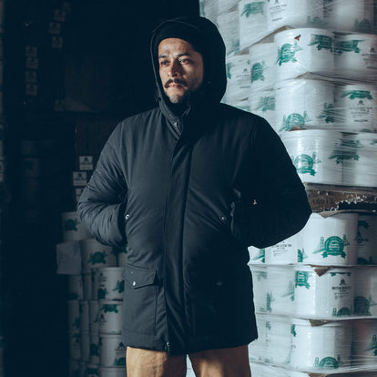 Our fit model wearing the Sierra Parka in an ice cream freezer