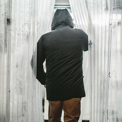 The back shot of our fit model in a freezer in san francisco