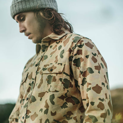 Our fit model wearing Yosemite Shirt in Camo while skateboarding