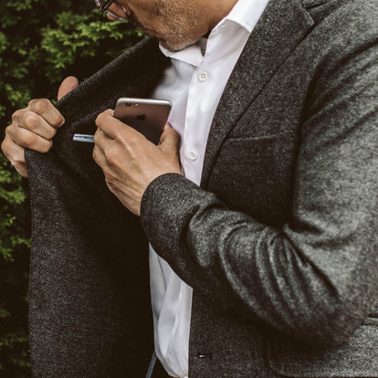 The fit model using the secret inside pocket in the Telegraph Jacket