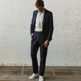 Our fit model wearing The Telegraph Trouser in Navy Boiled Wool by Taylor Stitch.
