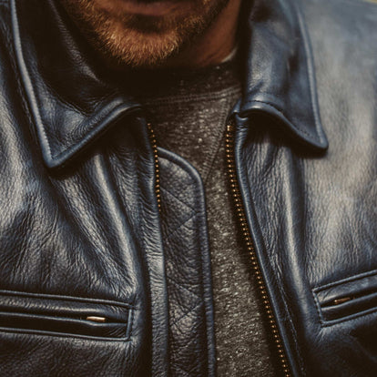 Detail shot of our fit model wearing the limited Midnight moto jacket