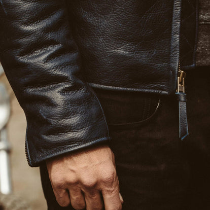 Cuff detail shot of our fit model in the Midnight moto jacket