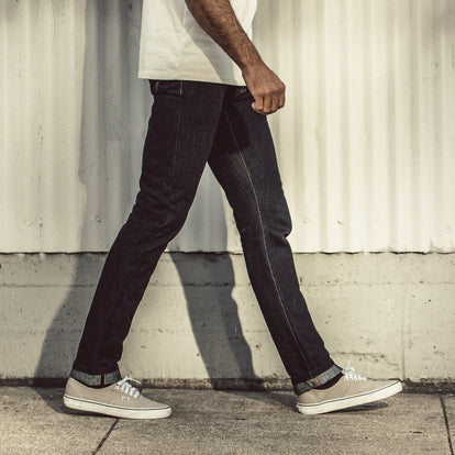 Our fit model wearing The Slim Jean in Sol Selvage Denim.