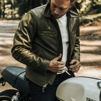 Our fit model wearing The Moto Jacket in Loden Steerhide