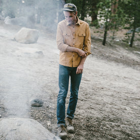 The fit model by the camp fire