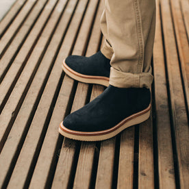 our fit model wearing The Ranch Low in Weatherproof Navy Suede—on a deck