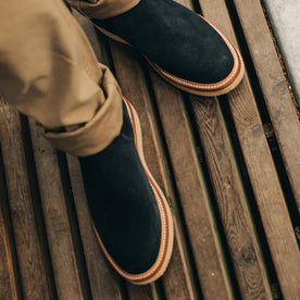 our fit model wearing The Ranch Low in Weatherproof Navy Suede—cropped shot looking down