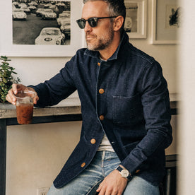 our fit model rocking The Ojai Jacket in Indigo Herringbone—sitting down drinking coffee