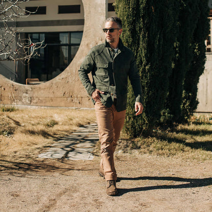 our fit model wearing The Project Jacket in Olive Boss Duck