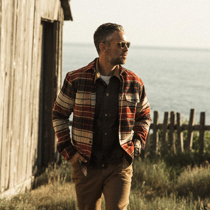 Our fit model wearing The Crater Shirt in Rust Plaid.