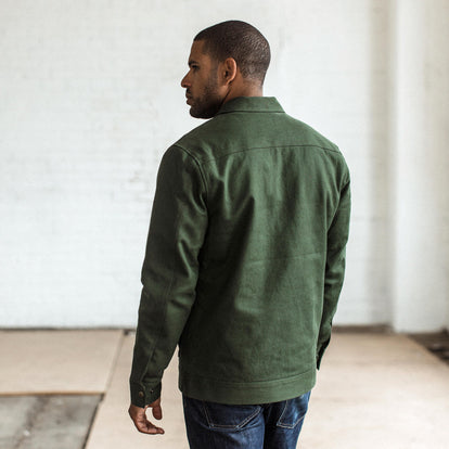 Our fit model wearing The Mechanic Jacket in Dark Olive Boss Duck