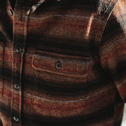 Our fit model in The Moto Utility Shirt in Sunset Stripe from Taylor Stitch.