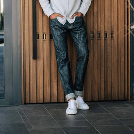 our fit model wearing the slim jean in Green Cast Selvage