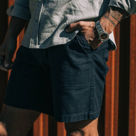 our fit model wearing The Trail Short in Navy Slub Sateen—cropped shot of left side