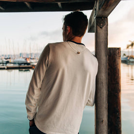 fit model wearing The Heavy Bag Long Sleeve in Natural, back shot looking at marina
