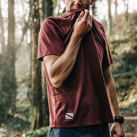 fit model wearing The Merino Tee in Wine, taking a breather