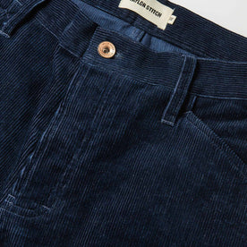 material shot of The Camp Pant in Indigo Corduroy—button and pocket shot