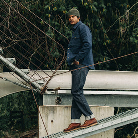 our fit model wearing The Democratic Jean in Cone Mills Reserve Selvage—walking on a dock