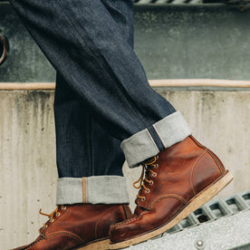 fit model wearing The Democratic Jean in Cone Mills Reserve Selvage, cuffed over boots