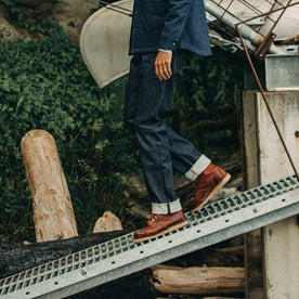 our fit model wearing The Democratic Jean in Cone Mills Reserve Selvage—cropped shot of waist down, walking left