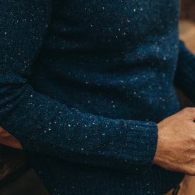 our fit model wearing The Hardtack Sweater in Navy Donegal—close up of right sleeve with cuff visible
