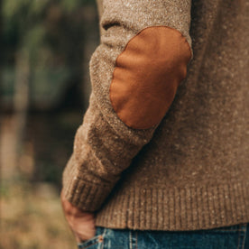 our fit model wearing The Hardtack Sweater in Oak Donegal—closeup of left elbow leather patch