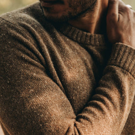 our fit model wearing The Hardtack Sweater in Oak Donegal—closeup of right bicep with cuff and collar visible