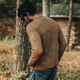 our fit model wearing The Hardtack Sweater in Oak Donegal—seen from left side angle with full back visible