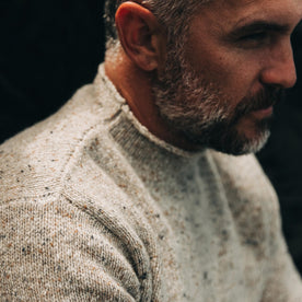 our fit model wearing The Seafarer Sweater in Natural Donegal—cropped shot looking left