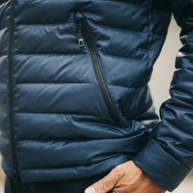 out fit model wearing The Taylor Stitch x Mission Workshop Farallon Jacket in Midnight Blue—material closeup of side zipper