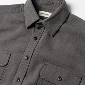 material shot of The Corso Shirt in Charcoal Double Cloth from the front with placket, collar, and chest pockets visible