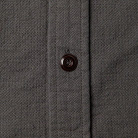 material shot of The Corso Shirt in Indigo Double Cloth closeup of the placket horn button