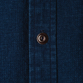 material shot of The Corso Shirt in Indigo Double Cloth close up of the horn button of the placket