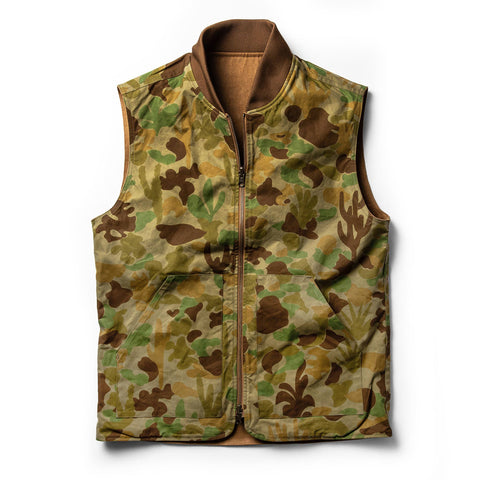 The Taylor Stitch x Gear Patrol Reversible Able Vest in Arid Camo - featured image