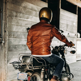 our fit model wearing The Band Collar Moto Jacket—on bike