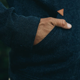 our fit model rocking The Après Hoodie in Indigo Waffle—cropped shot of hand in pocket