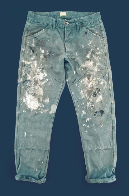 A pair of worn and torn chore pants