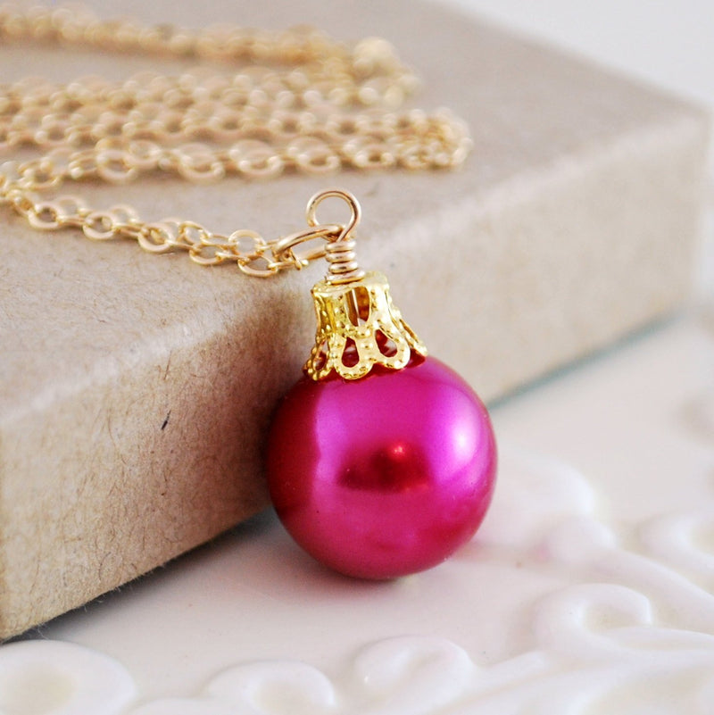 Fuchsia Necklace, Christmas Ball, and Glass Pearl