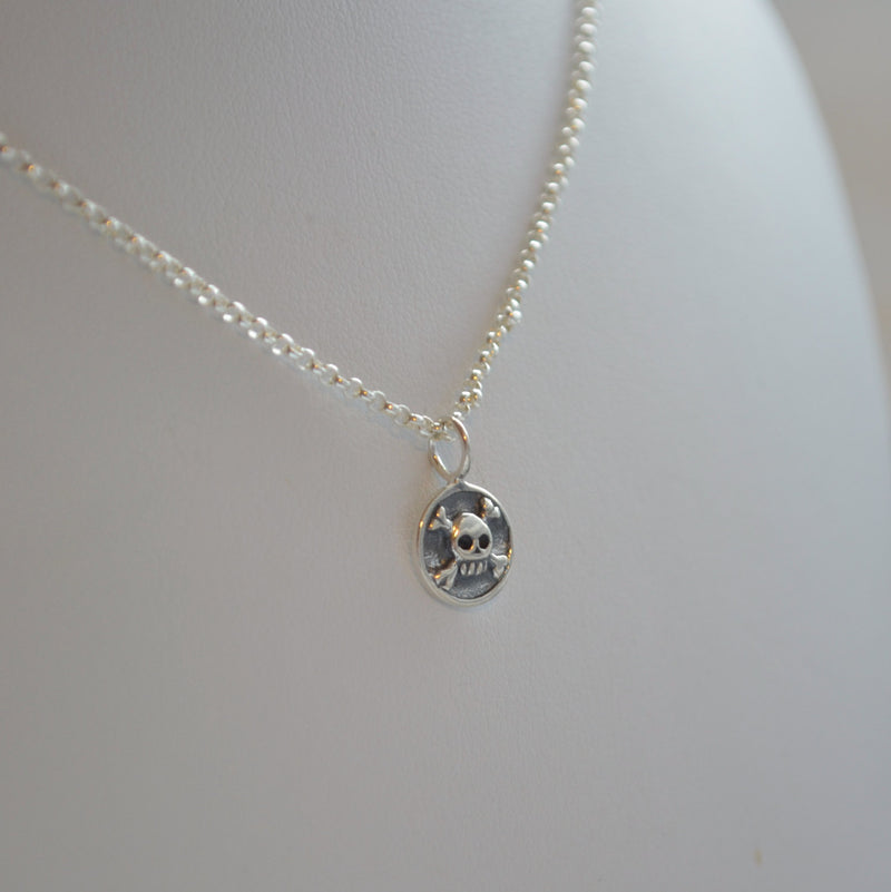 Tiny Skull and Crossbones Necklace in Sterling Silver